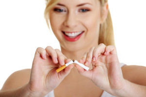 nonsmoker girl breaking cigarette